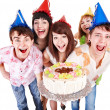Group of in party hat with cake. — Stok fotoğraf