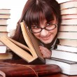 Clever girl in spectacles with group book. — Stock Photo #3320271