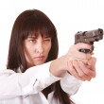 Beautiful young woman with gun. — Stock Photo #3320292