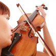 Aggressive young girl with fiddle. - Foto Stock