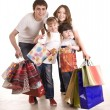 Happy family and children shopping. - Stock Photo