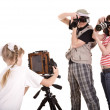 Happy family with three camera. — Stockfoto