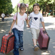 Children with suitcase run. — Stock Photo #3320851