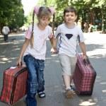 Children with suitcase run. — Stock Photo #3320851