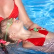 Swimming Instructor learn child swim. - Stock Photo
