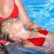 Swimming Instructor learn child swim. — Stock Photo #3320875