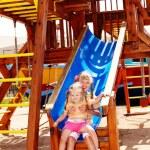 Children on slide in playground. Outdoor park. — Stock Photo #3320884