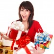 Beautiful girl in red with group gift box. — Stock Photo