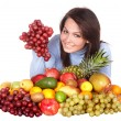 Stock Photo: Girl with group of fruit and vegetables.