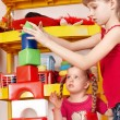 Child plaing block and construction set in preschool. — Stock Photo