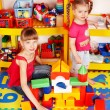 Child with puzzle, block and construction set in play room. - Foto Stock