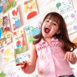 Little girl painting picture in preschool. — Stock Photo