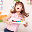 Child with paint in art class . — Stock Photo