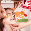 Child with paint of face in play room. — Stok fotoğraf