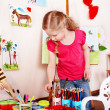 Child draw paints in play room. — Stock Photo #3321213