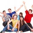 Stock Photo: Group of happy young with hand up.