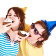 Man in party hat and girl eating cake. — Stock Photo #3321337
