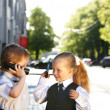 Children in business suit with mobile phone outdoors. — Photo
