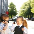 Children in business suit with mobile phone outdoors. — Foto de Stock