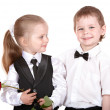 Children in business suit with rose. — Stock Photo