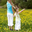 Stock Photo: Children in field with flower.