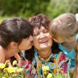Grandmother with daughter and granddaughter outdoors. — Stock Photo