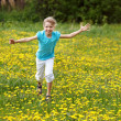 Happy child running in field. — Stock Photo
