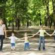 Family with three children outdoor. — Stock Photo #3321547
