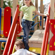 Children on slide outdoor in park. — Stock Photo