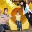 Family with children on slide outdoor. — 图库照片