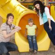Family with children on slide outdoor. — Stock Photo