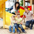 Foto de Stock  : Family with children on slide outdoor.