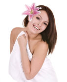 Girl with towel and flower in beautician spa. — Stock Photo