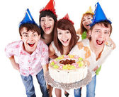 Group of in party hat with cake. — Stock Photo