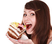 Girl eating piece of cake. — Stock Photo