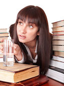 Girl with heap book and cup. — Stock Photo