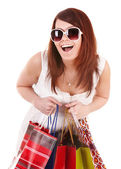 Girl in white glasses with shopping bag. — Stock Photo