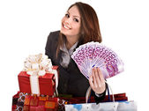 Girl in business suit with money euro, gift box, bag. — Stock Photo