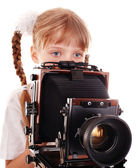 Child with old wood large format digital camera. — Stock Photo