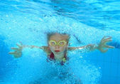 Child swim underwater in pool. — Stock Photo