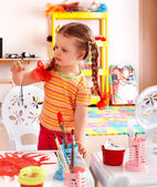 Child with paint and brush in playroom. — Stock Photo