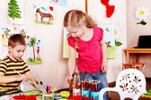 Child draw paints in play room. — Stock Photo