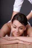 Beautiful girl having thai massage. — Stock Photo