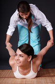 Beautiful white girl having thai massage. — Stock Photo