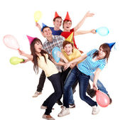 Group of teenage in party hat and baloon. — Stock Photo