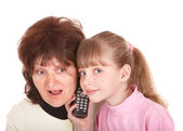 Grandmother and granddaughter call by phone. — Stock Photo