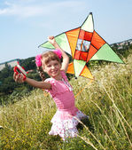 Girl in green grass fly kite. — Stock Photo
