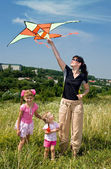 Happy family and children fly kite. — Foto Stock