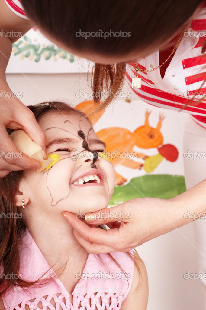Child with paint of face in play room. Make up. — Stock Photo #3321200