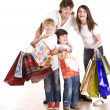 Happy family and children shopping. — Stock Photo